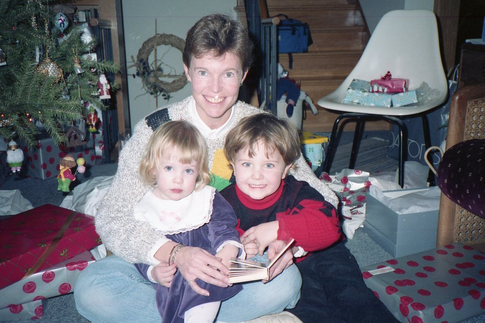Me (in the purple dress) with my cousin Chris and my mom in 1988.