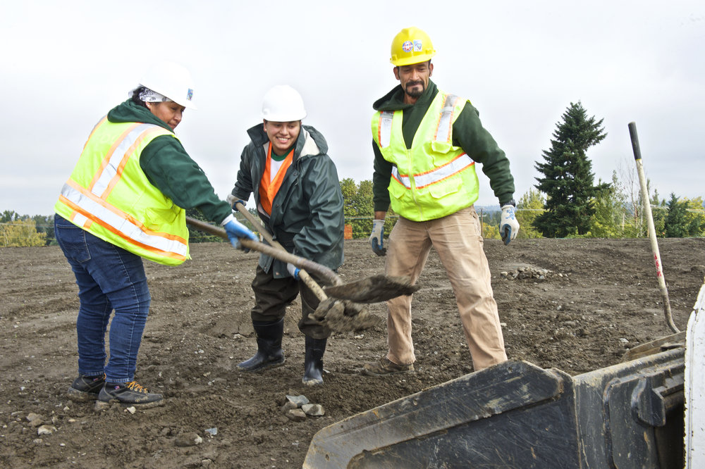 Verde Landscape Crew Member Rosa, Karen and Antonio prepare the grading at Cully Park.