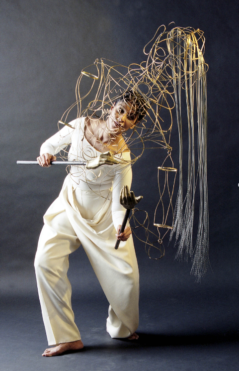 Gitanjali Kolanad dances with the brass-wire folk-style puppet.
