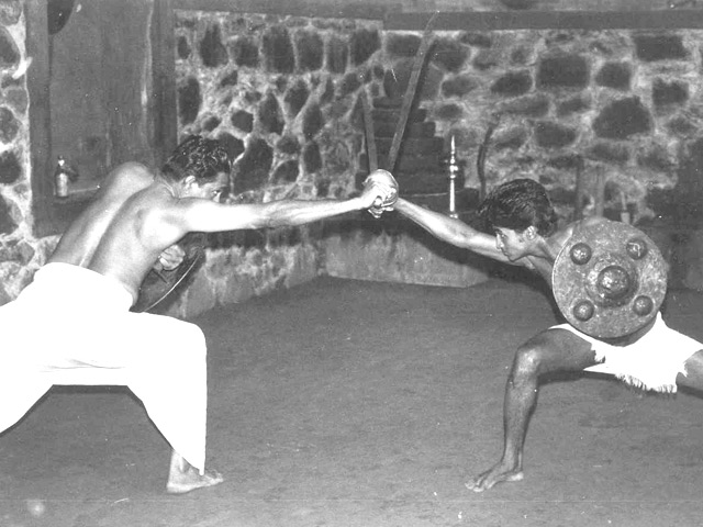 Gurukkal Govindankutty Nayar and Rajashekeran Nayar practicing sword and shield, 1977.