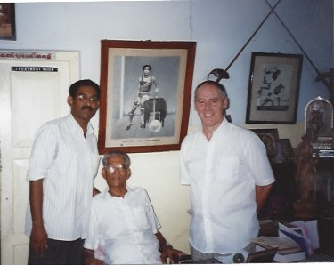 Phillip Zarrilli with Gurukkal Govindankutty Nayar and Sathyan in the office at CVN Kalari, Thiruvananthapuram. The image behind Gurukkal is of his father, CV Narayanan Nayar.
