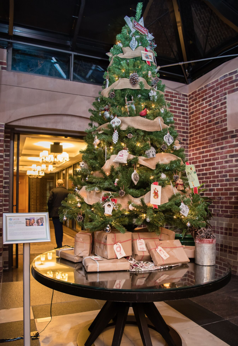 A chic and neutral tree spruced up with burlap and natural ornaments keep things classic and timeless this holiday season -not to mention kid and family friendly. -