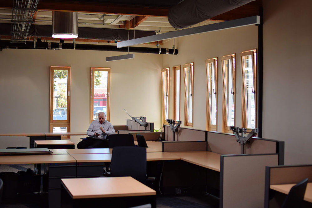 Lit by skylights and windows, the main open office area does not require artificial lighting during average work hours. The operable windows provide natural ventilation.