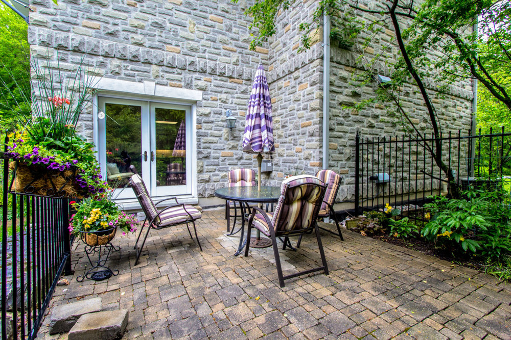 1050-16thSideroad - Small Back Patio - Keller Williams Referred Urban Realty.jpg
