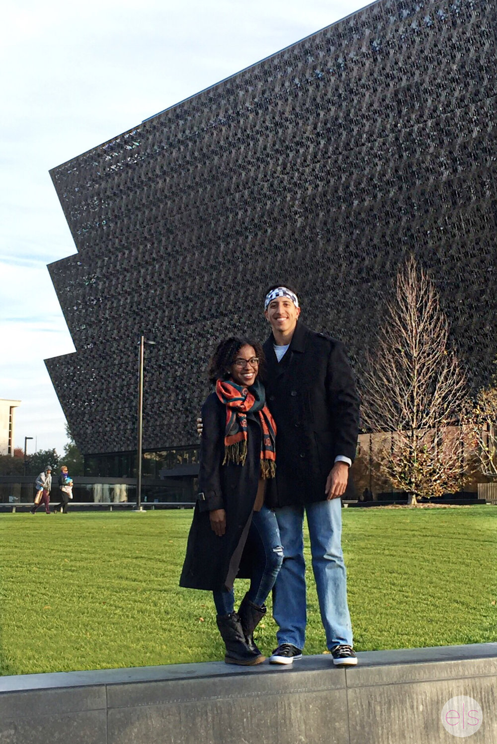 With bae in front of the Smithsonian for African American Arts & Culture.