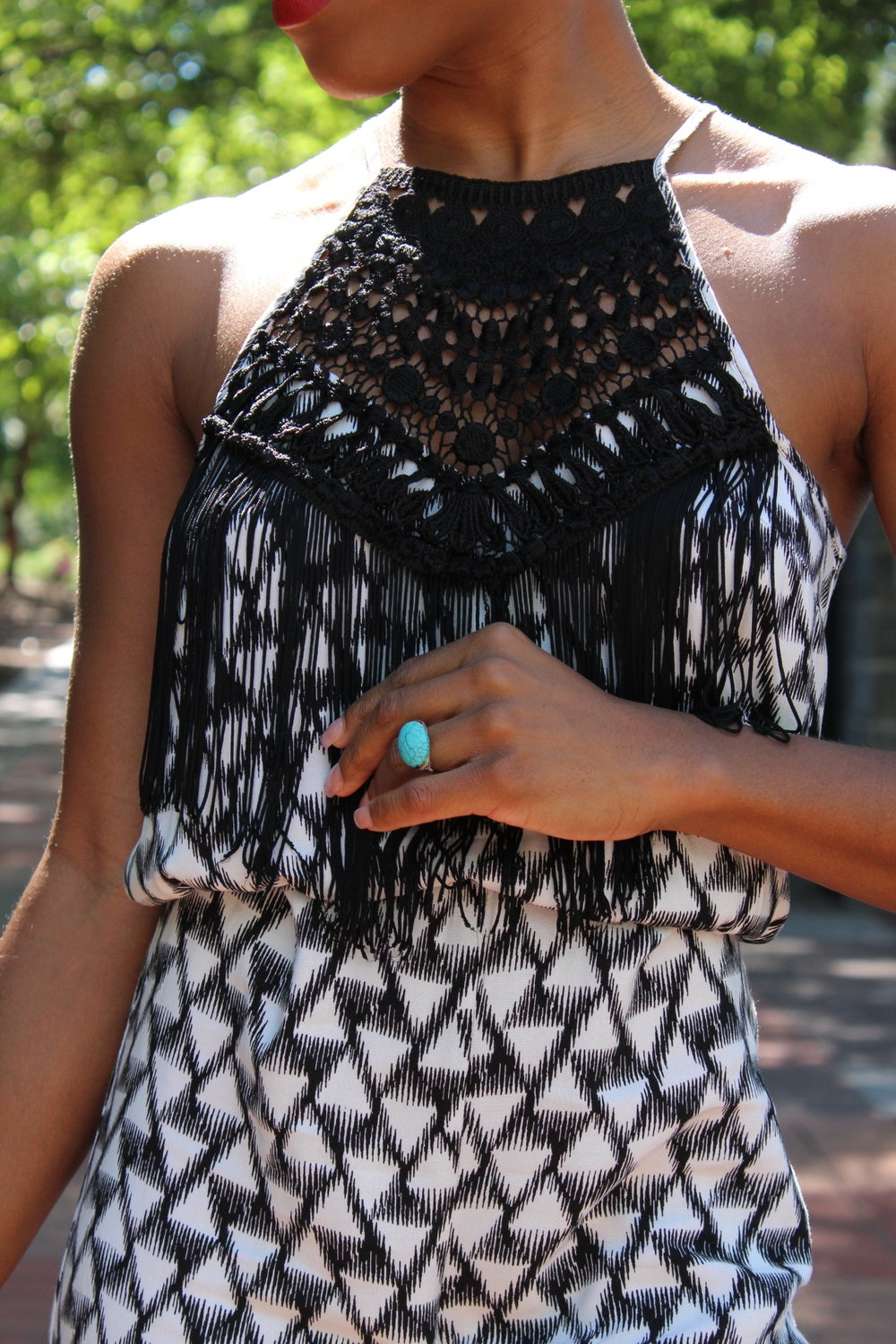 The detail on this romper is like wearing a necklace!