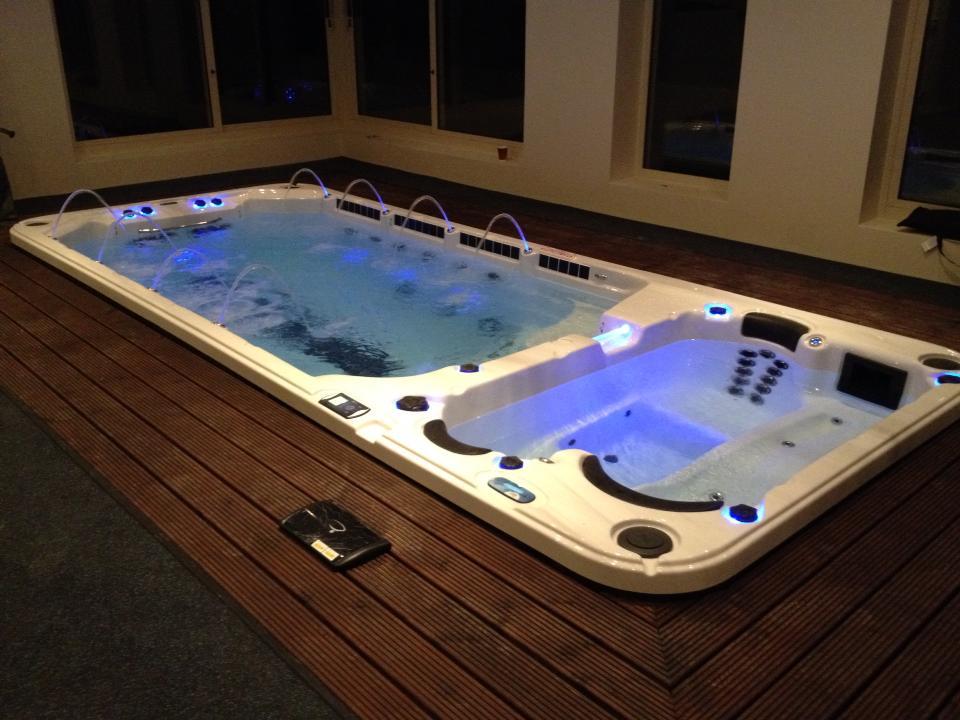 Sun Room Installation swim spa indoors harbor hot tubs