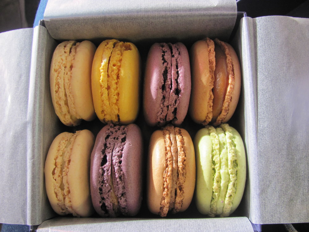 Orange Blossom, Lemon, Cassis, Salted Caramel, Ginger and Pistachio boxed Laduree Macarons.