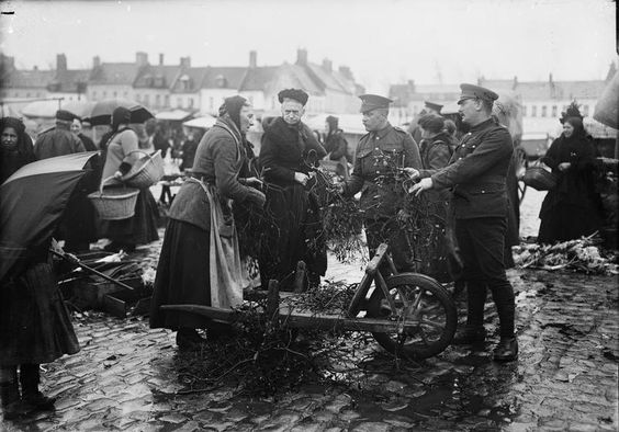 Behind the line in Bailleul, France, soldiers buying mistletoe.