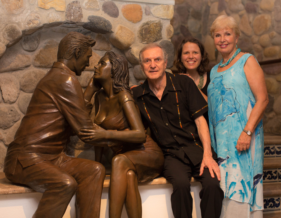Jim Demetro, daughter Christina, and wife Eva, with sculpture Los Amantes.