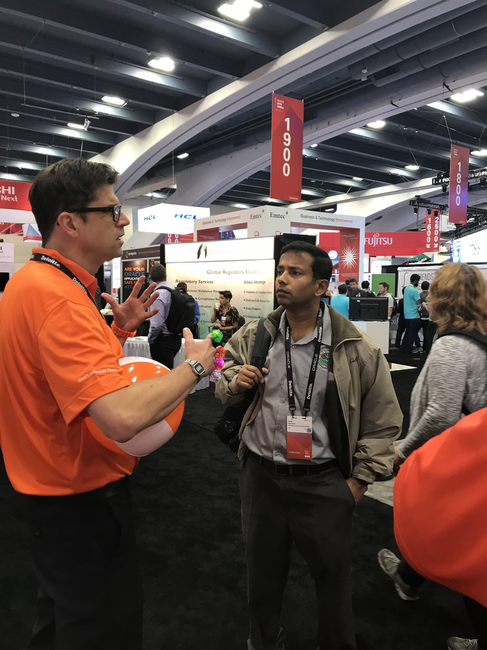 trade show emcee engages prospect at OOW