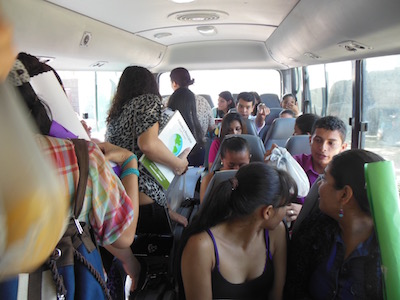 University bus on way to grade schools