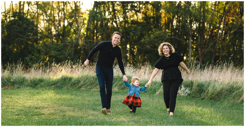 """I do work hard to get some traditional """"everyone looking at the camera and smiling"""" formal portraits.  But during each session, I prompt families to spend some times just interacting, connecting, and having fun. Sometimes, those candid moments can even be more valuable than posed photos."""