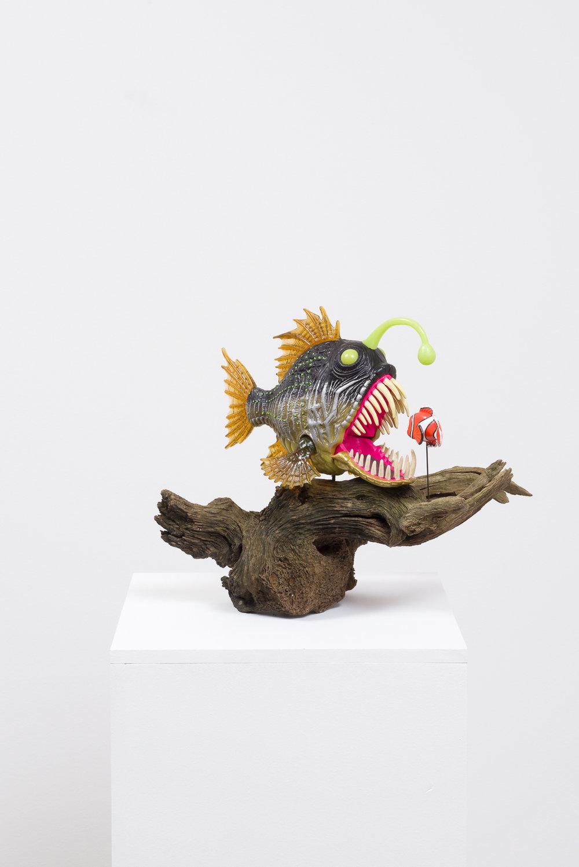 Eating Nemo , 2017  Driftwood, plastic toys, pedestal