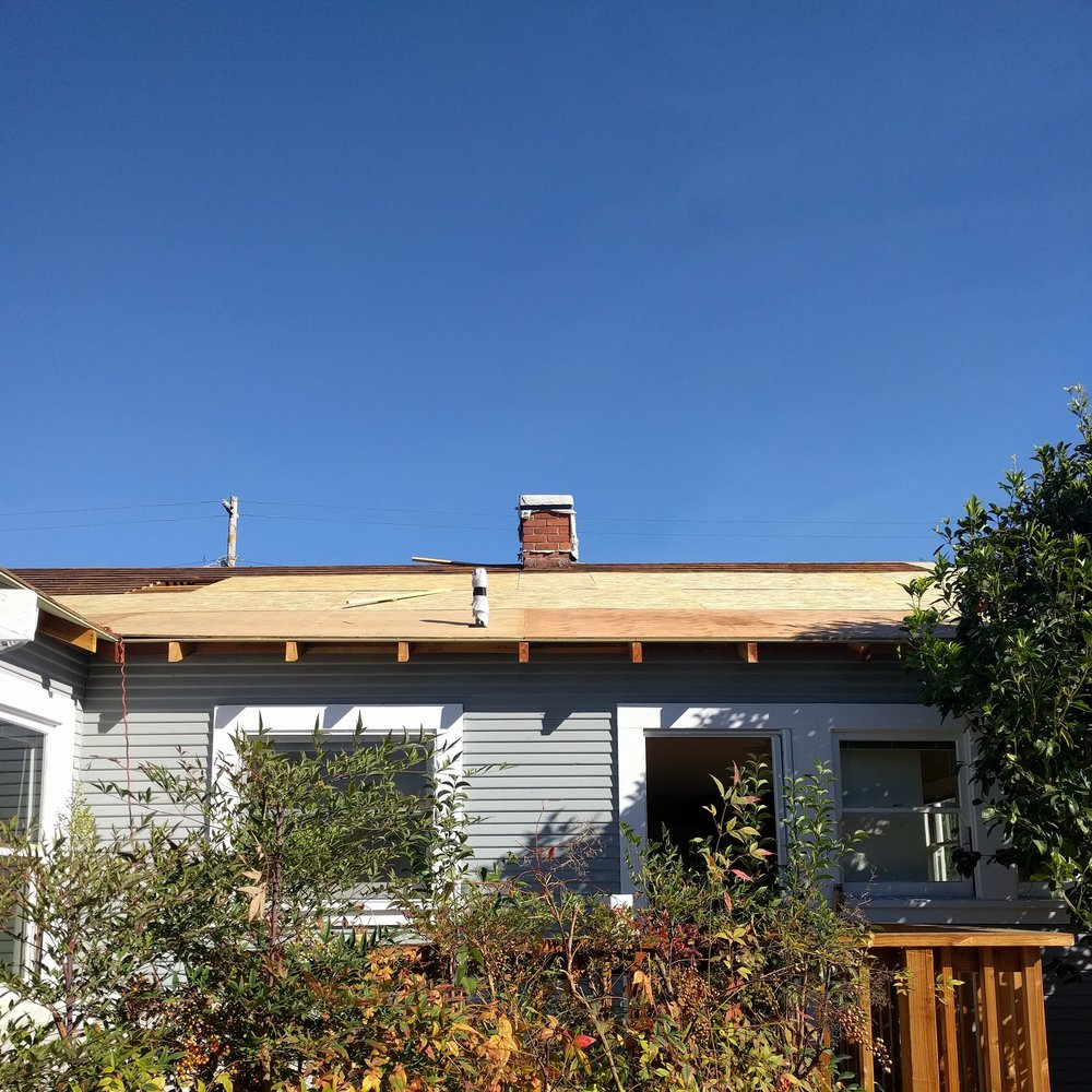 "The rear of the house now has new eaves and sheathing instead of ""skylights."""