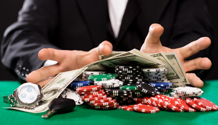 poker player with chips and money at casino table
