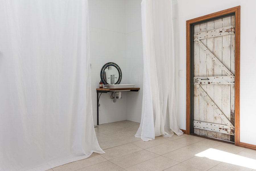 The Studio: Bathroom, toilet and privacy curtains.