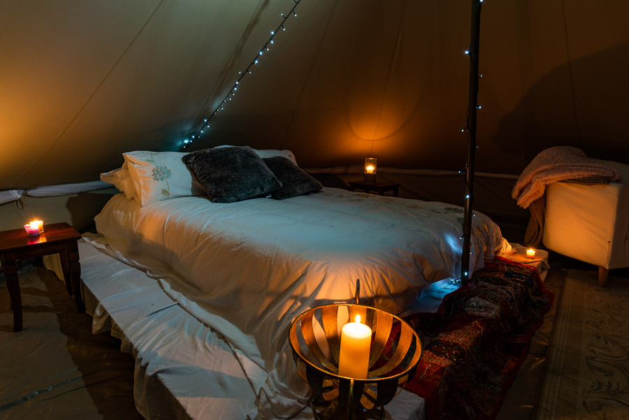 The Tent House - Najanuga: Interior, queen size bed at night.