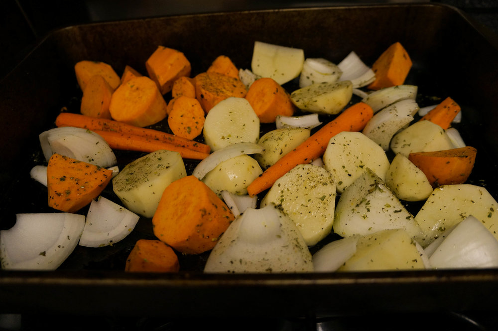 The perfect vegetables for alongside - potatoes, sweet potatoes, onion, and carrots.