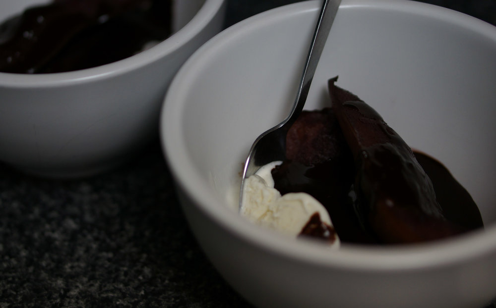 Poached pears with red wine chocolate sauce and vanilla ice-cream.