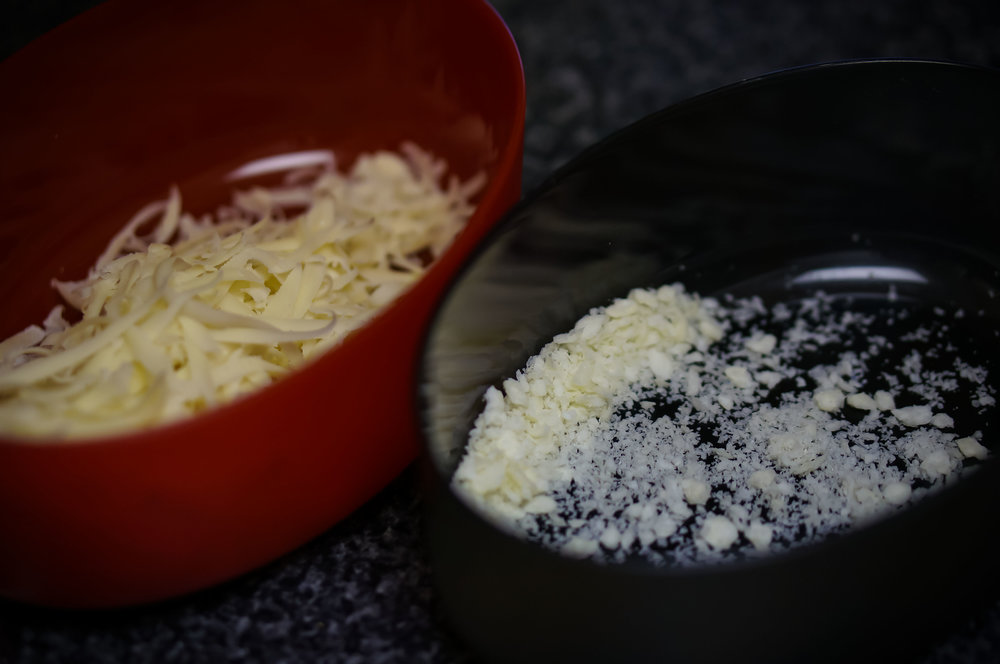 Two cheeses? Why, that'll require two graters, and two grater container attachments, of course!