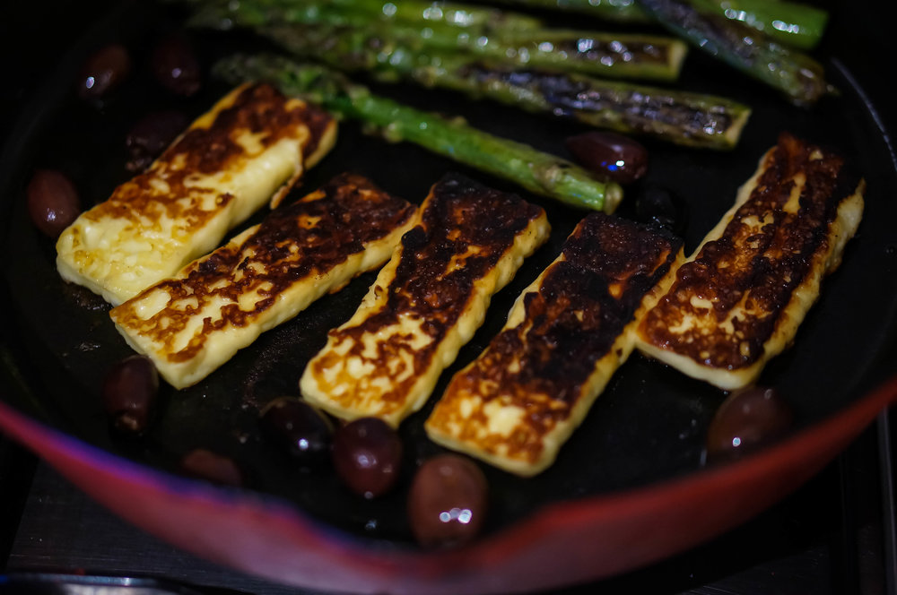 Haloumi, asparagus and olives cooking