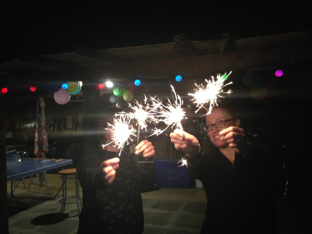 Two total sparklers (holding some fireworks).