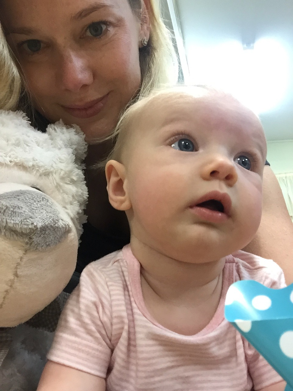 Enjoying a teddy bear's picnic at Amelie's baby sensory class. Here she is doing her usual thing, watching what everyone else is doing and ignoring my silly singing and playing!