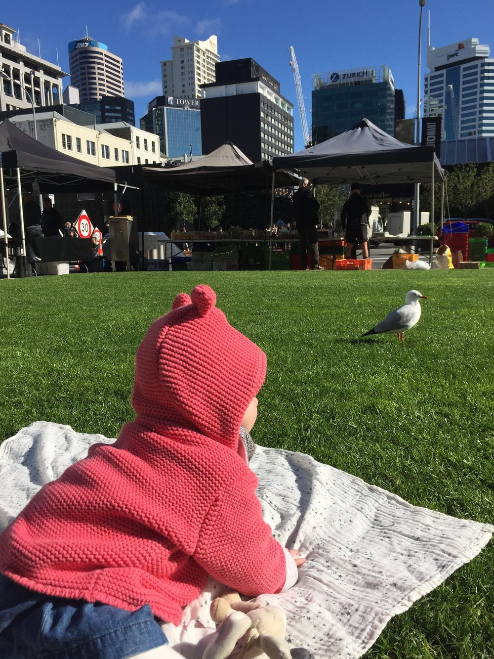 A bit of contrast – the city from down low. Amelie loved watching this bird from the safety of her makeshift picnic blanket.