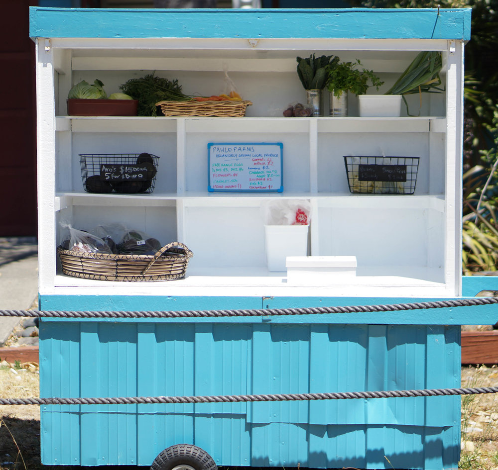 Fruit and vegetable stand in Waihi Beach. I kind of want to live in this perfect little cart.