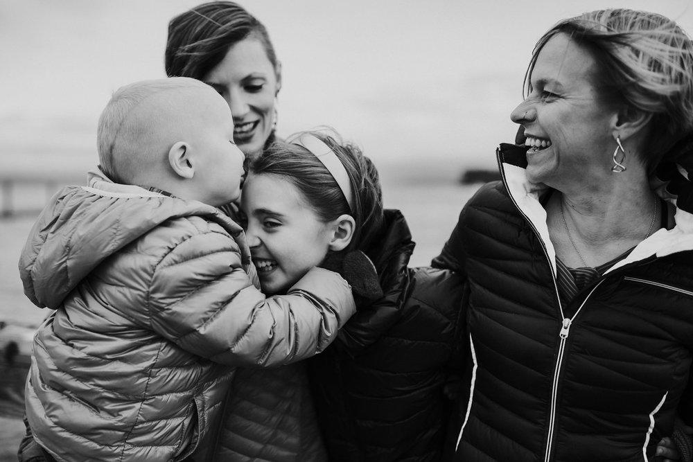 Lesbian parents snuggle kiddos on Coupeville Wharf | Coupeville, WA Family Photographer