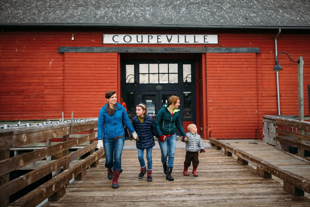 Same-sex couple run down wharf with kids | Coupeville, WA Family Photographer