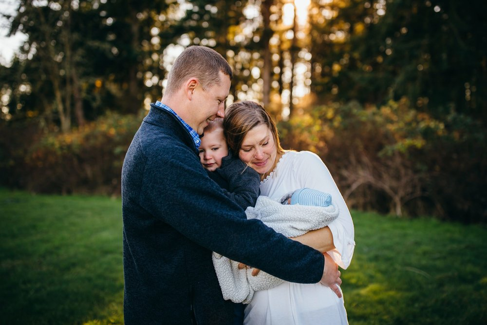 Beautiful Family Snuggles Baby on Bed | Whidbey Island Newborn Lifestyle Photographer