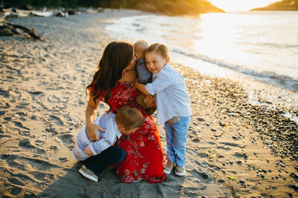 Mother embraces three boys on beach | Whidbey Island Family Photographer