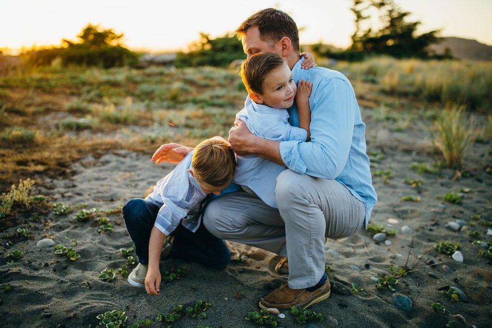 Dad hugs boys on Washington beach | Whidbey Island Family Photographer