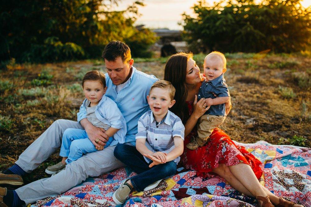 Family sings song on beach | Oak Harbor Family Photographer