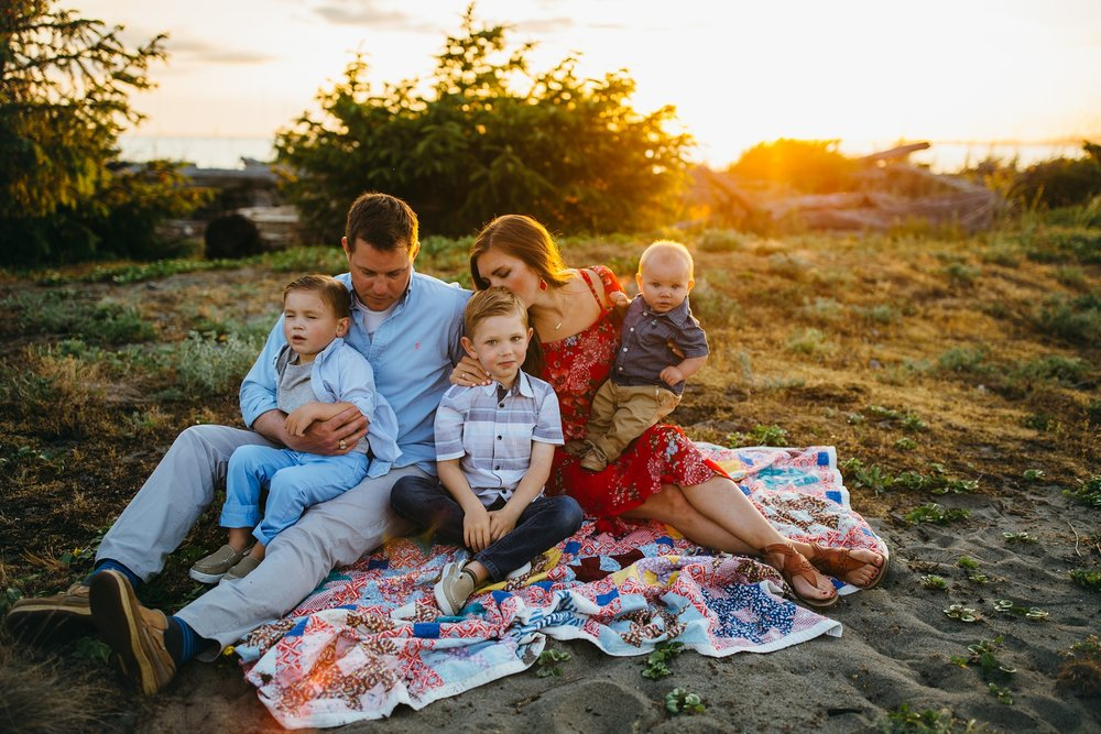 Family sits in field | Oak Harbor Family Photographer