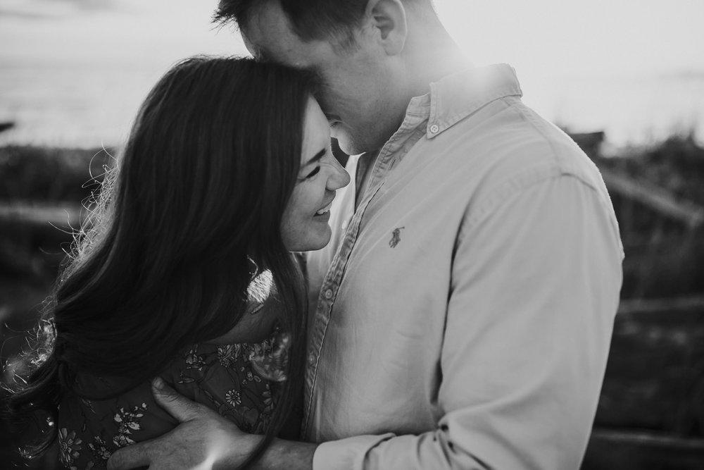 Couple laughs at Deception Pass beach | Oak Harbor Family Photographer