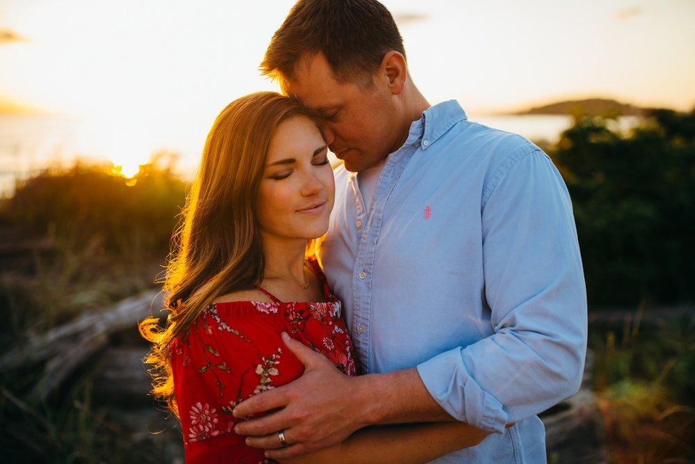 Husband hugs wife on beach | Oak Harbor Family Photographer