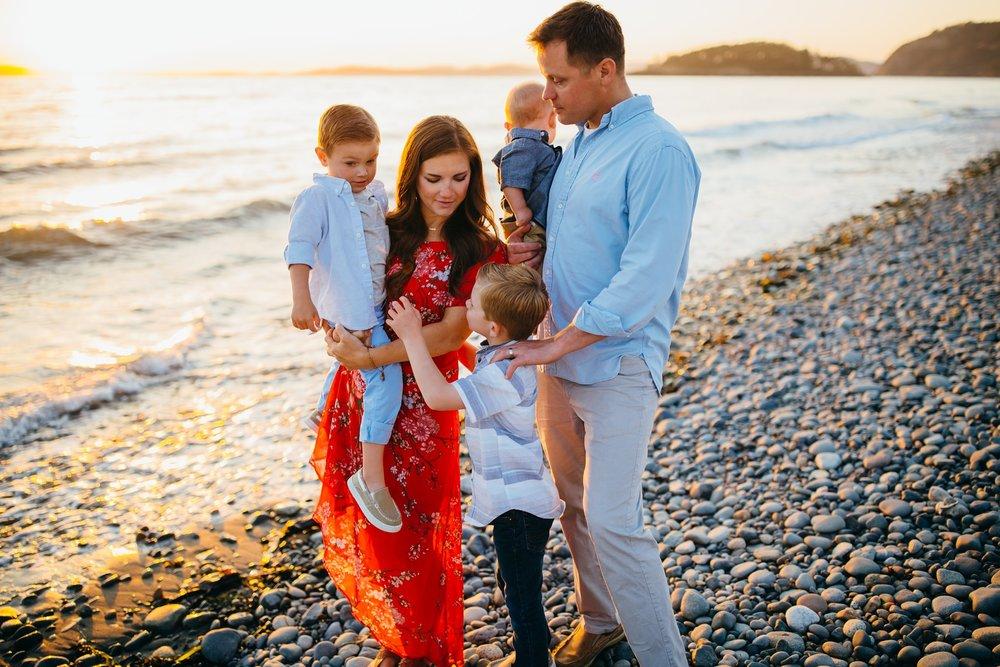 Family walks along beach at sunset | Oak Harbor Family Photographer