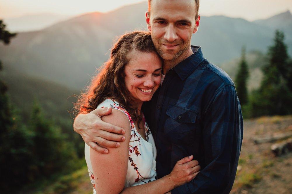 couple embraces at hurricane ridge