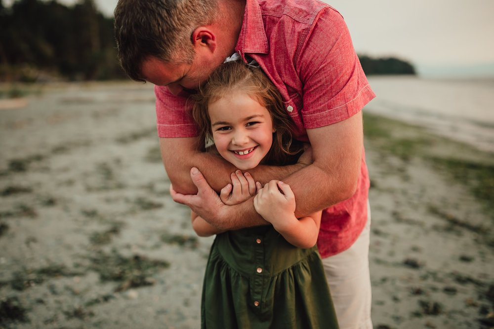 dad hugs daughter on Washington beach | Best Washington family photographer
