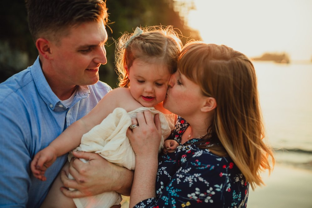 """""""I can't even begin to describe how perfect they are."""" - """"Kara captured my family the way I see us - the pride in my husband's eyes, my daughter's mischievous laugh. I am so grateful for this precious gift."""" - Carly"""