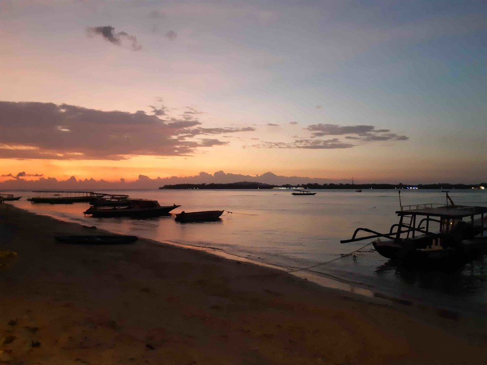James Buchanan | Sun setting over Gili Meno