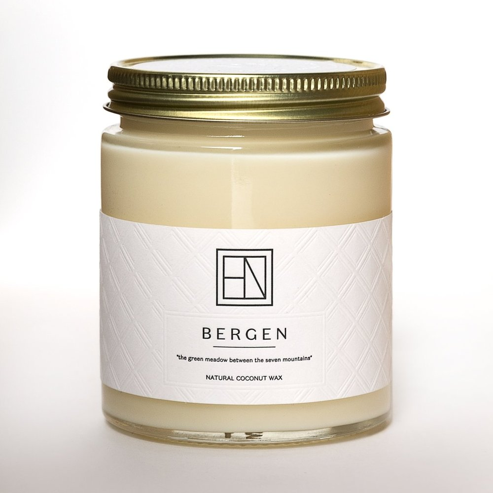 BERGEN is inspired by the seven green mountains that embrace the city.    Scents of pine needles blended with the crisp sea breeze and hint of woodwork from the grand hanseatic Bryggen port    Whiffs of the artic rain that wash the ancient cobblestones and nourishing the lush and blooming rhododendron.