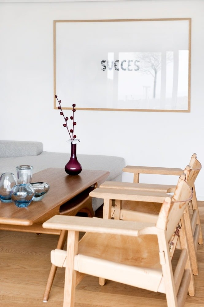 Vintage Danish coffee table by Johannes Andersen and Børge Mogensen Spanish chairs with great vintage patina together with modern art from Julie Nord.
