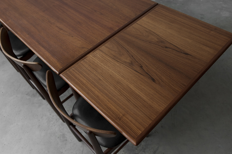 Vintage 1960's Danish teak dining table with extension plates.