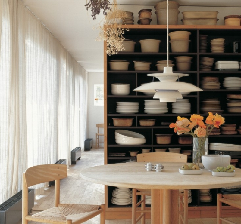 Grethe Meyer's dining room is filled with ceramics of her own design and furniture pieces by her friend, Børge Mogensen. The cozy shaker dining table and J39 chairs by Mogensen sit beneath another Danish classic, the PH 5 pendant lamp from 1958, designed by Poul Henningsen for Louis Poulsen.