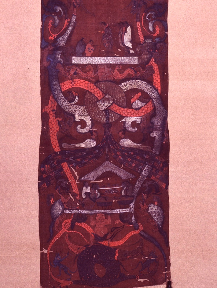 Telamone con serpenti e nodi celesti/ Telamon with snakes and celestial nodes    Drappo funerario della tomba di Dai. Dipinto su seta, epoca degli Han Occidentali (c. 168 BC), part. /  Drape from the tomb of Dai. Painting on silk, Western Han Age (c. 168 BC), detail.   Hunan Province (China) National Museum, Tombs of Mawangdui