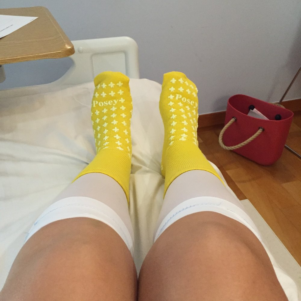 Not the first use of compression socks I was expecting but sexy nonetheless!
